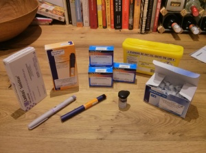 "My first prescription! Insulin pens for injecting, spare needles, the expensive testing strips and a ""sharps"" disposal box"