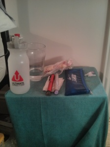 The Bedside table of a type one diabetic: water, insulin (fast and slow acting), JDRF pencil case to carry it around in, emergency jelly babies, old needle packets!