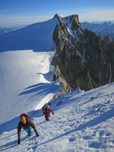Climbing up the snow slope to the Maudit ridge with Tacul in the background