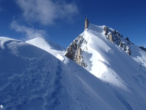 The summit of Mont Maudit is the spike of rock. Mont Blanc is the white dome in the back ground