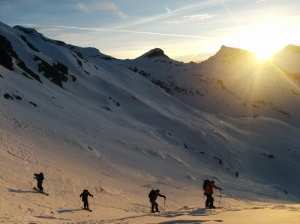 Skinning up above the hut at sunrise. Only 1400m vertical to go!